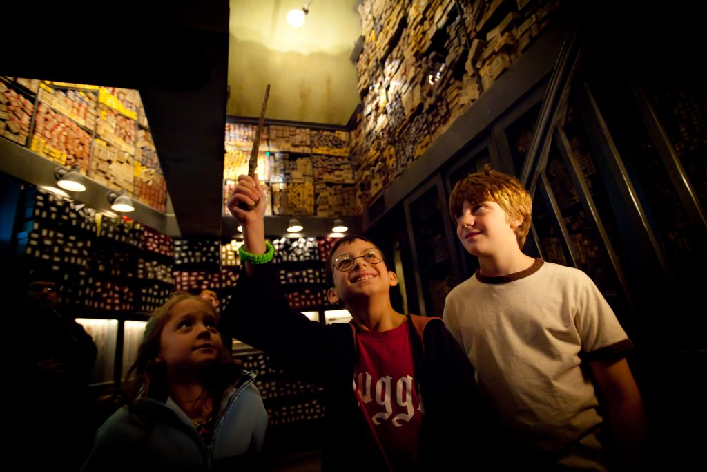 Visit Ollivanders wand shop and experience the wand choosing you! © 2015 Universal Orlando Resort. All rights reserved.