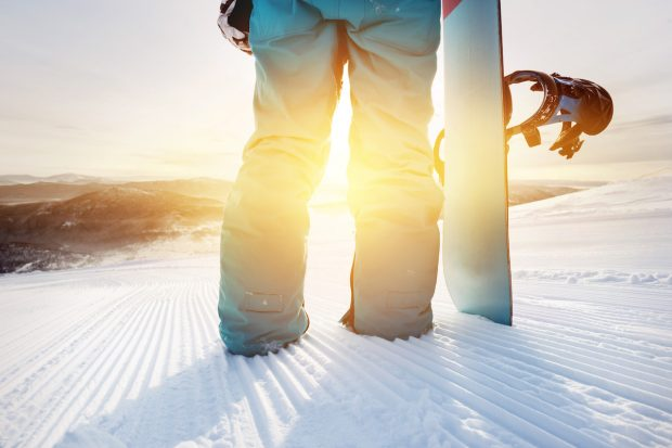 close up of a snowboarder