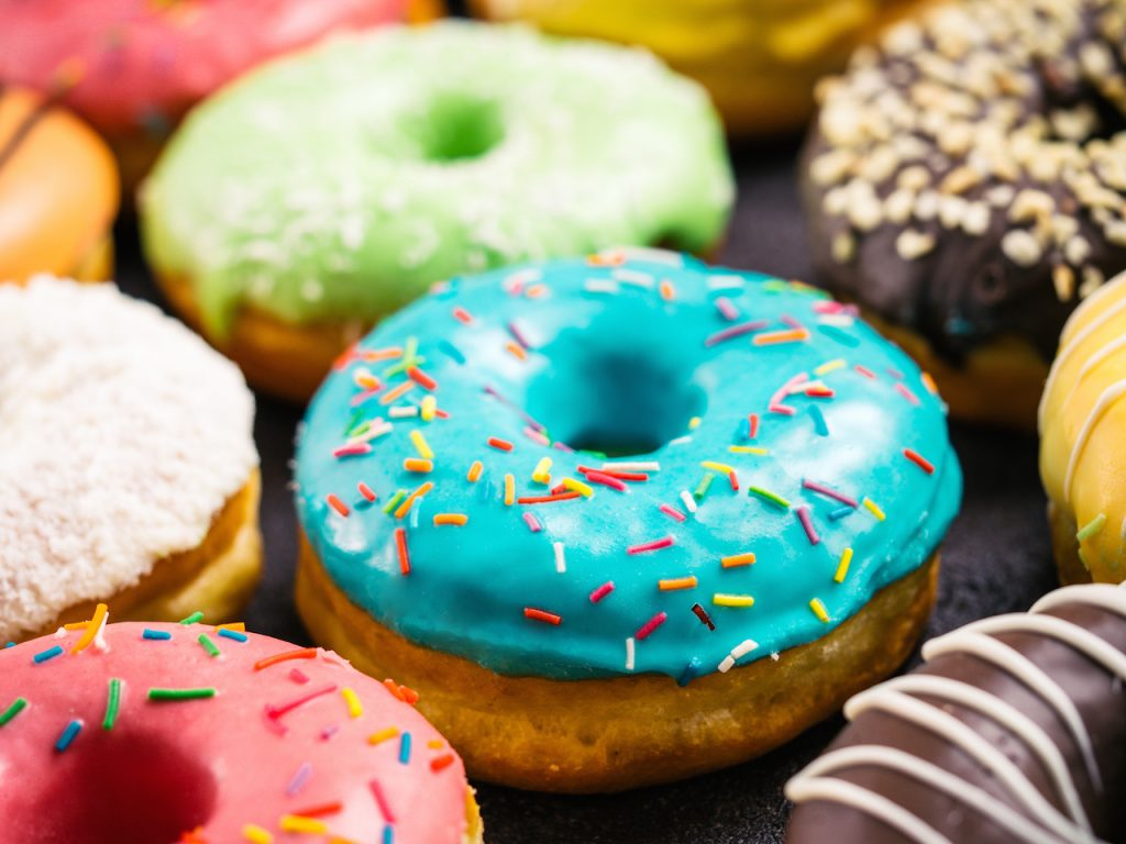 close up of assorted colorful donuts