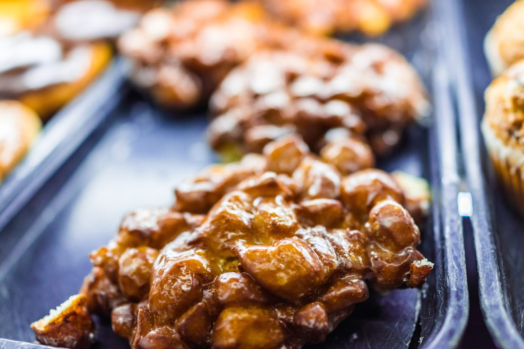 close up of an apple fritter donut