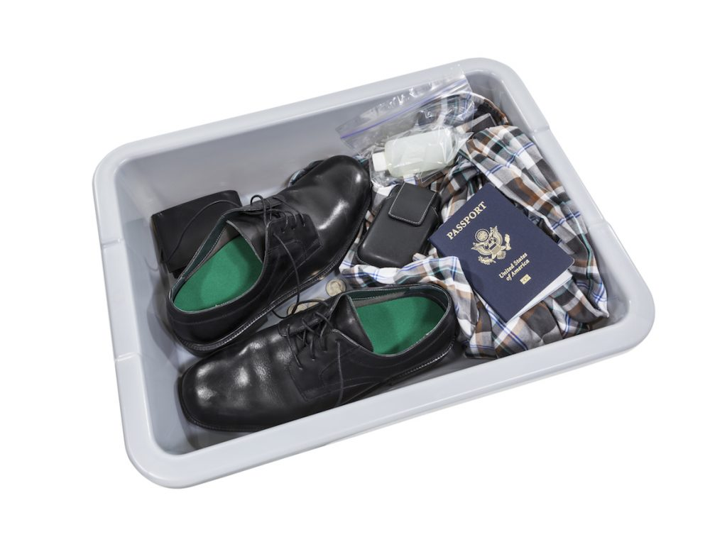 Airport screening security tray isolated with clipping path