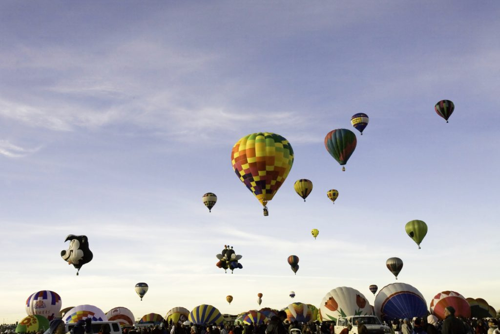 Hot air balloons in a mass ascent during the annual Albuquerque International Balloon Fiesta in New Mexico