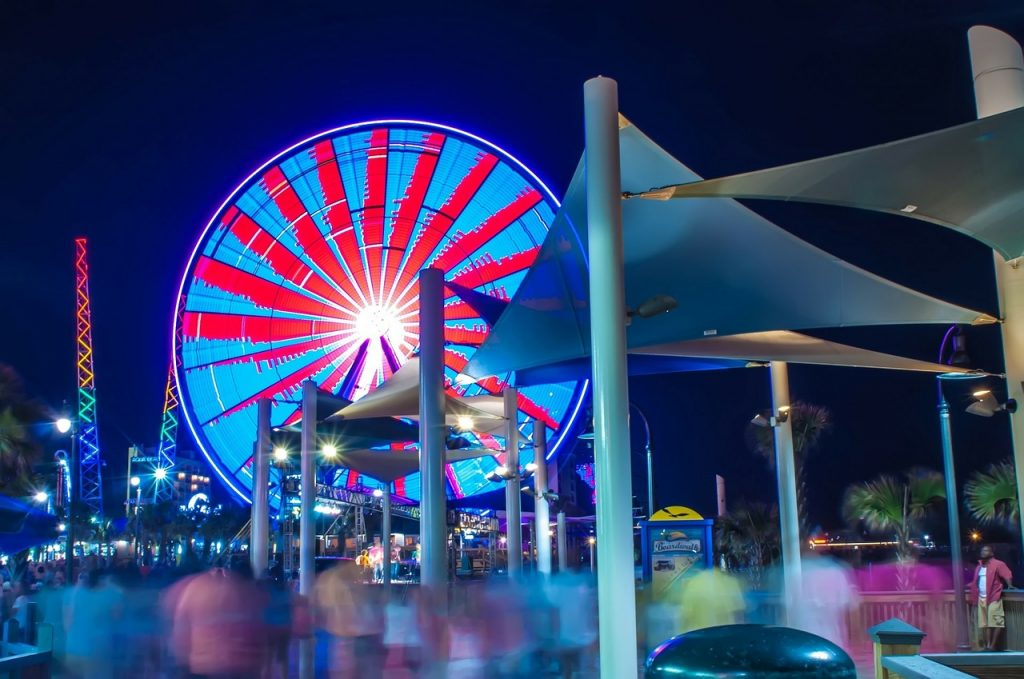 Lit up ferris wheel at night on Myrtle Beach