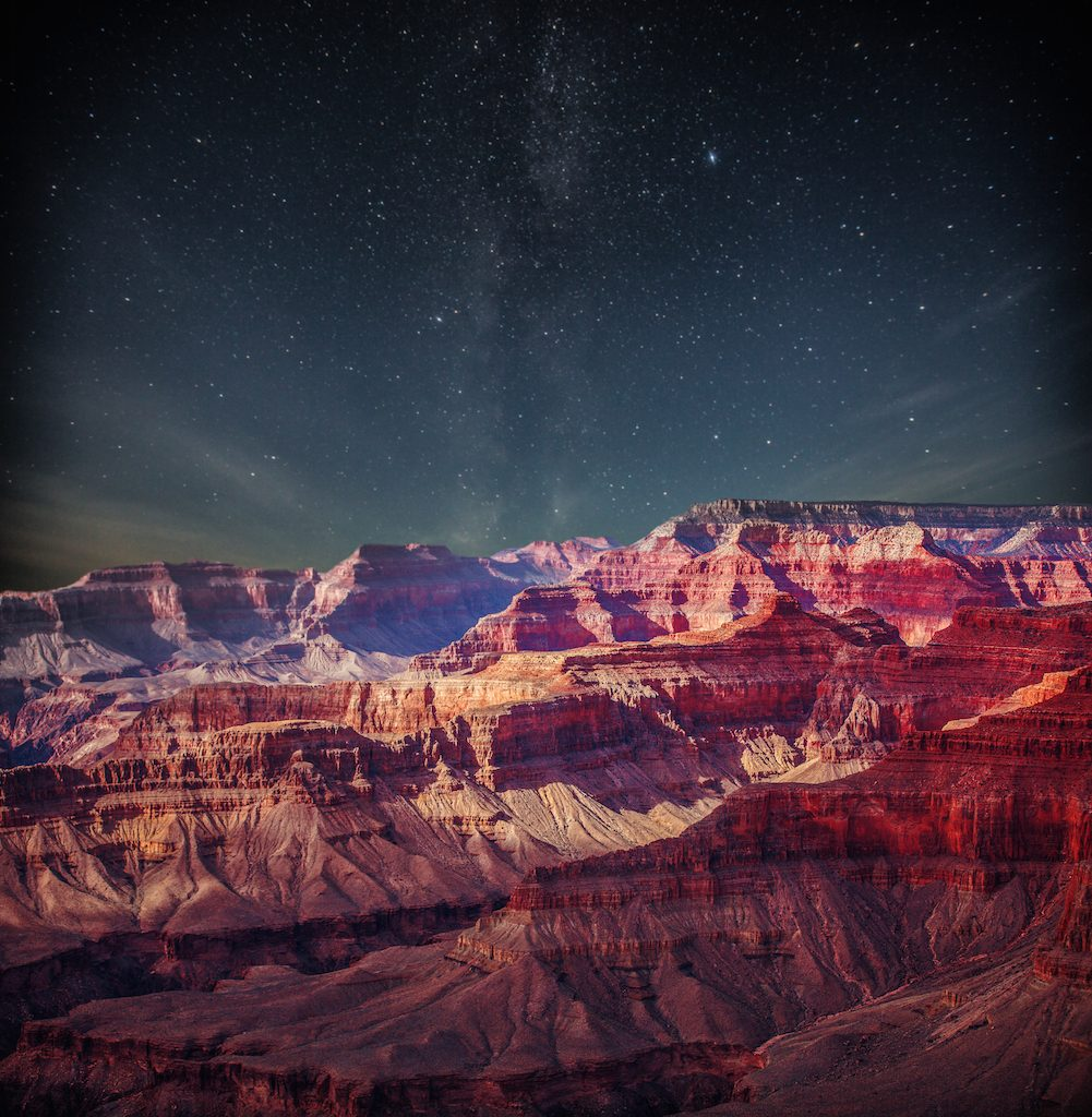 Grand Canyon at night under the light of the stars in the sky