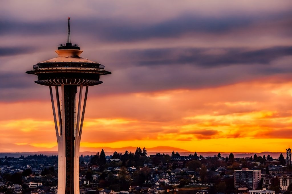 Space Needle in Seattle, during an orange and purple sunset
