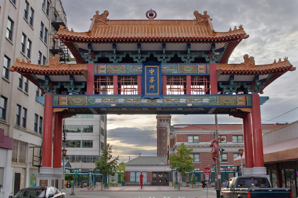 Sunset at Chinatown Gate with Union Station in Seattle Washington