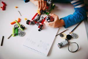 little boy building robot at robotic technology school lesson, STEM education