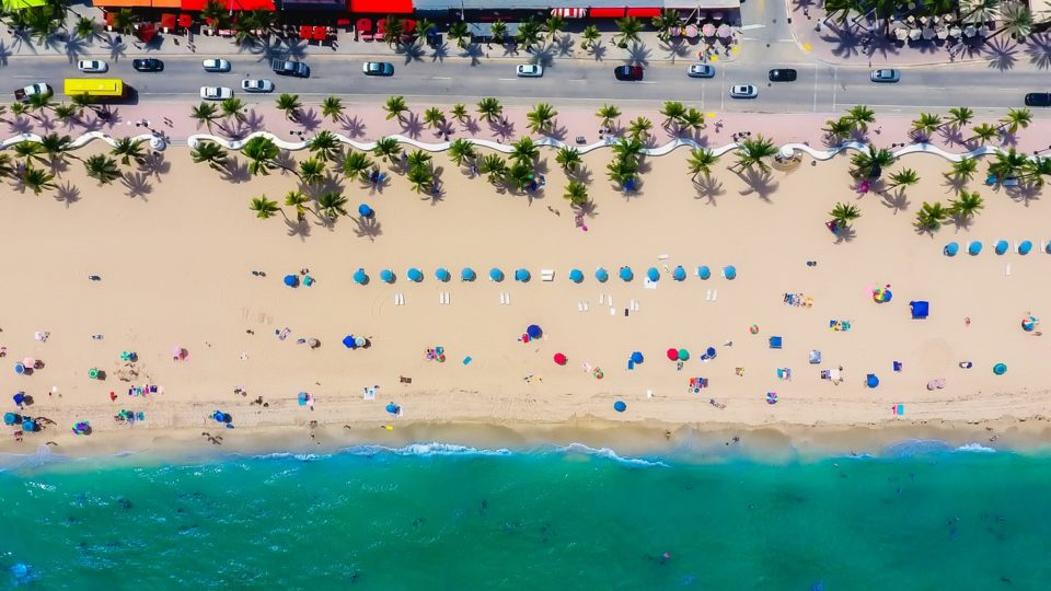 Aerial view of Ft. Lauderdale beach. View of the water, beach umbrellas and cars