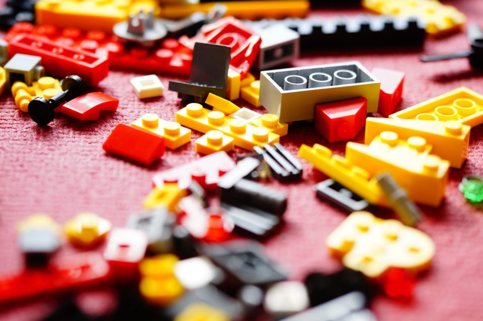 colorful legos spread out on the floor, or a desk