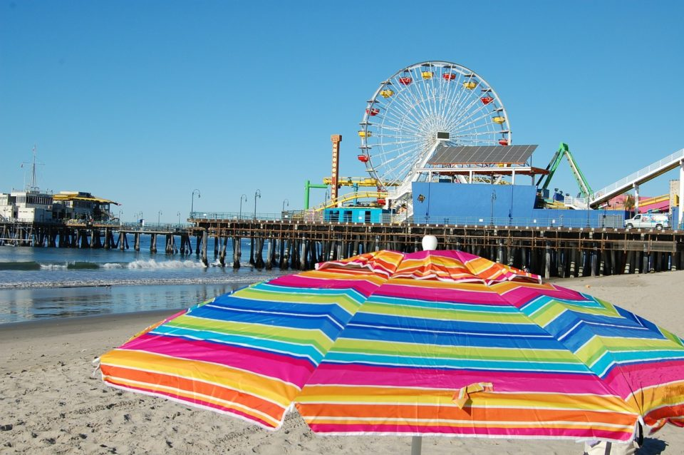 Colorful umbrella and feris wheel in Santa Monica Pier, California
