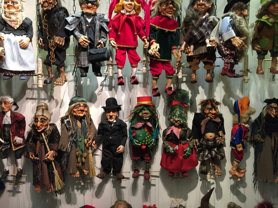 A whole wall filled with puppets