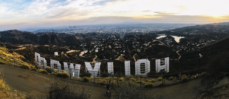 backwards Hollywood sign in California with view overlooking it