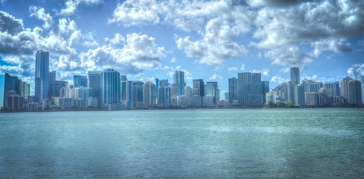 Miami Fl during a bright blue sunny day, view of the water and tall buildings in the city