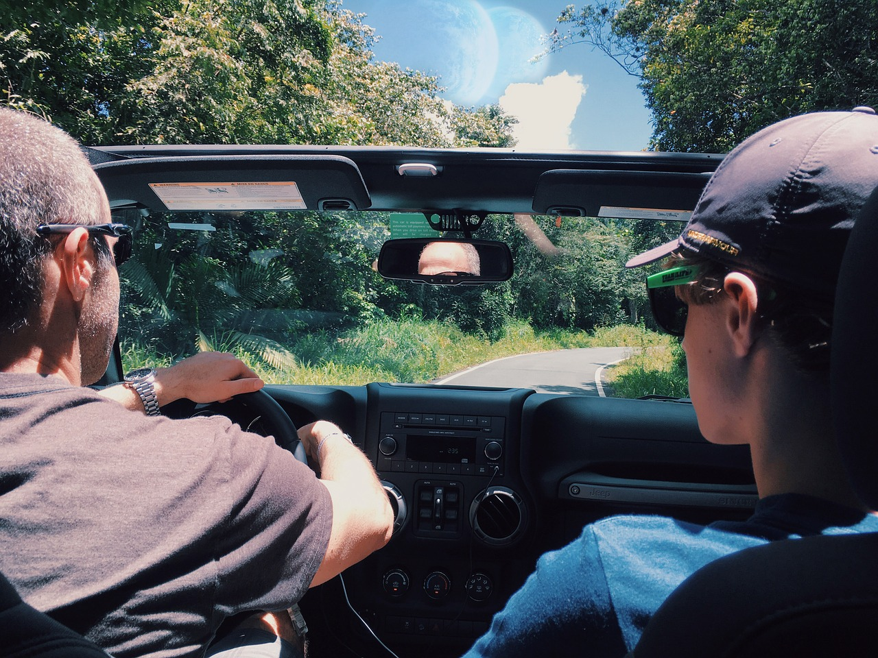 two guys traveling in a car together, dad and son bonding time