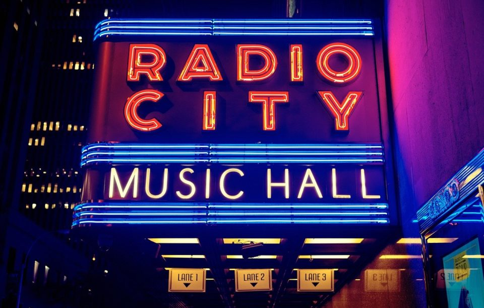 Radio City Music Hall neon sign lit up at night in NYC
