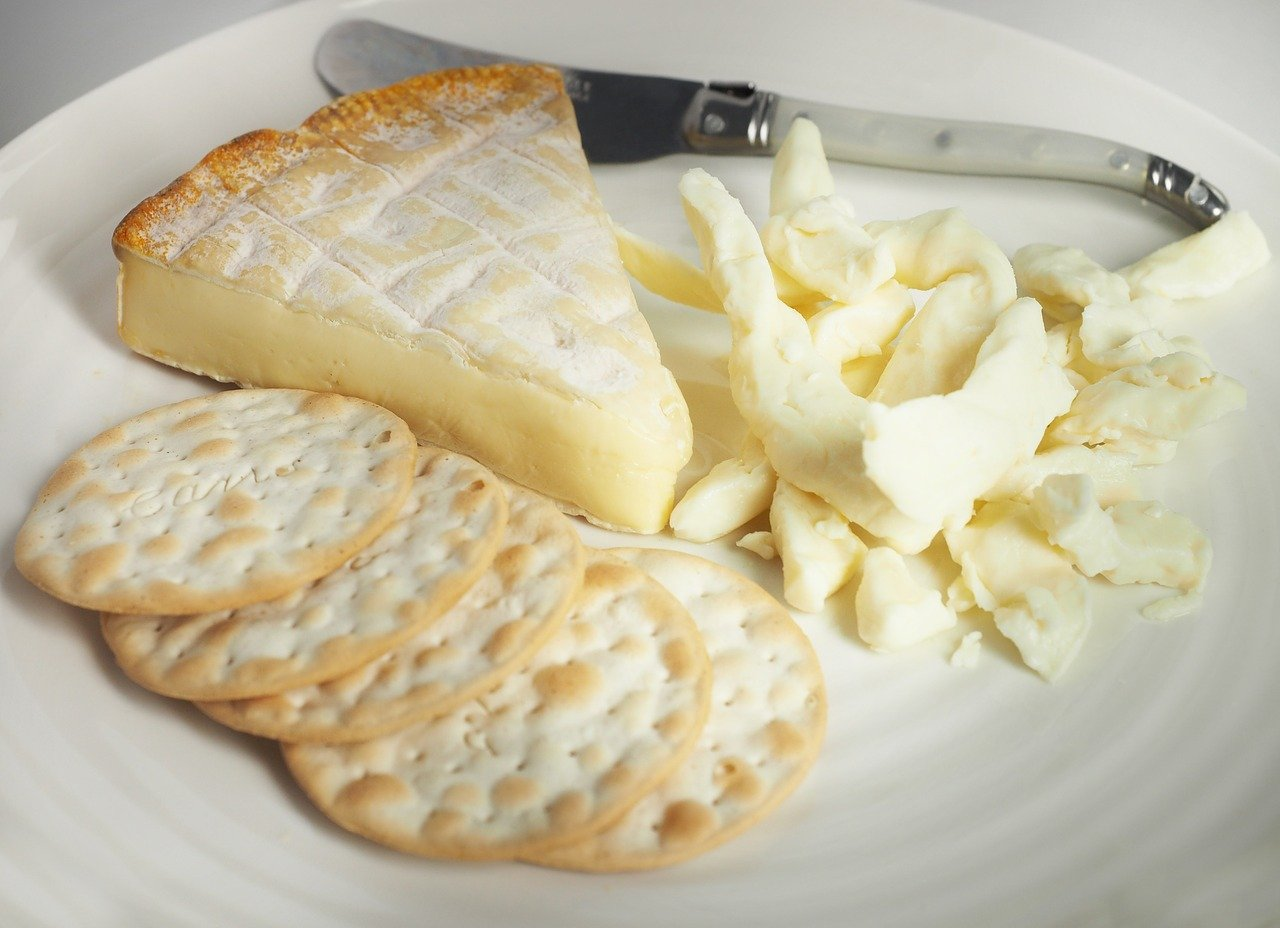 plate with cheese curds and crackers