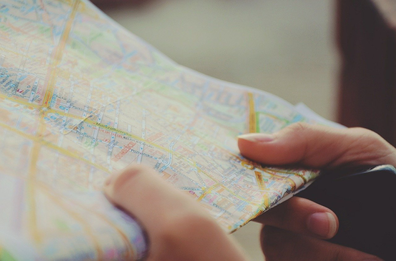 close up of a woman's hands holding a travel map