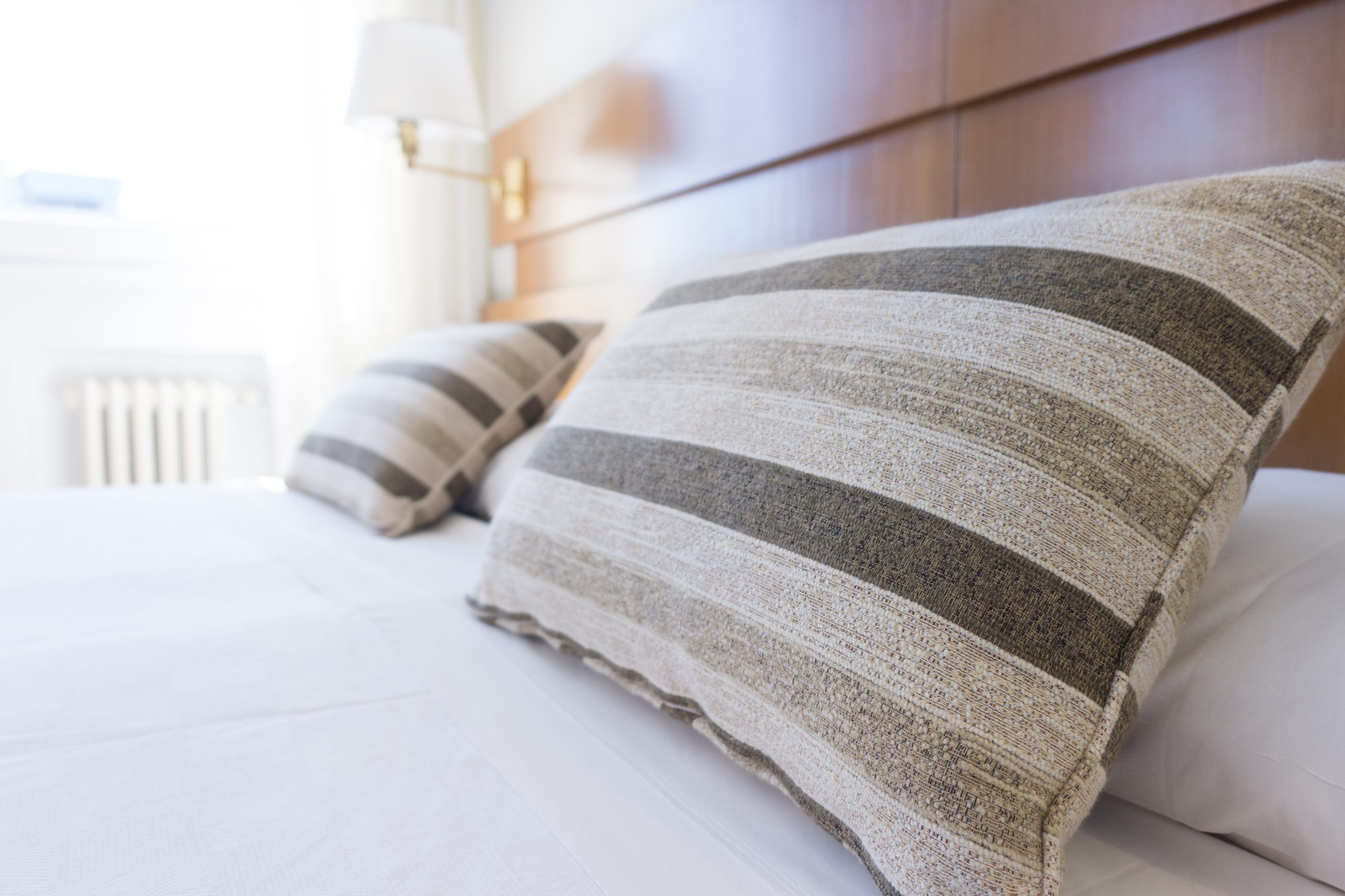 decorative pillows on a hotel bed