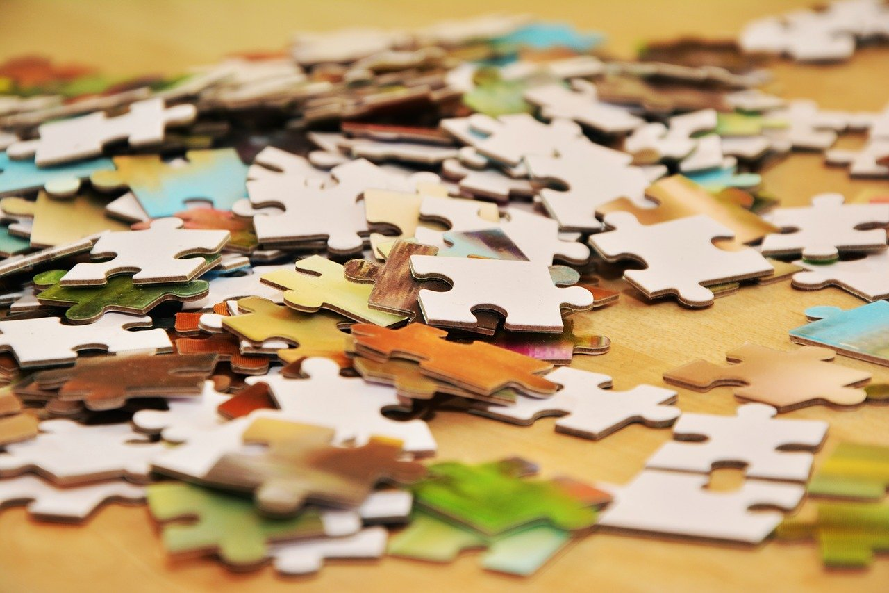 colorful puzzle pieces scattered on the table