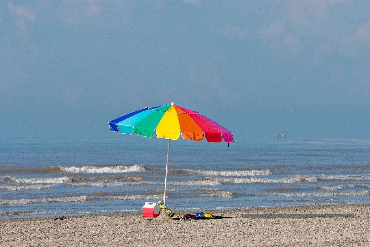 solo, colorful beach umbrella on the beach