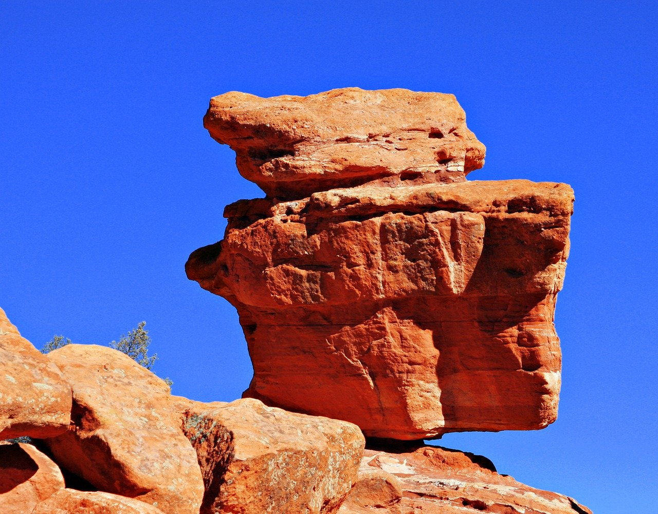 balancing red rocks inside of the Garden of the Gods, Colorado