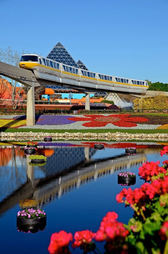 view of colorful flowers and the train inside of Epcot, Orlando